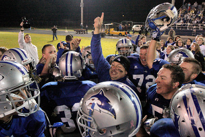 Josh Jackson/The Times-Standard  Head Coach Mike Benbow and the Fortuna Huskies celebrate their victory after Friday's game in Fortuna.