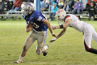 Josh Jackson/The Times-Standard  Huskies' #80 escapes the tackle of Eureka's #5 during Friday's game in Fortuna.