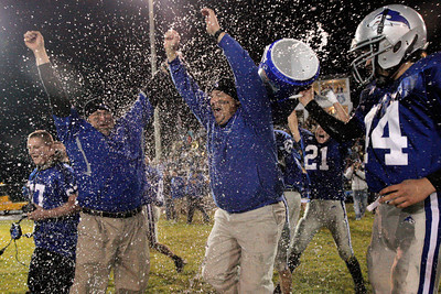Josh Jackson/The Times-Standard  Huskies Head Coach Mike Benbow is soaked after leading Fortuna to victory after Friday's game in Fortuna.