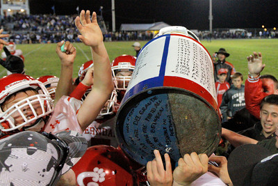Josh Jackson/The Times-Standard  The Ferndale Wildcats hoist the Milk Can after winning Friday's game in Fortuna.