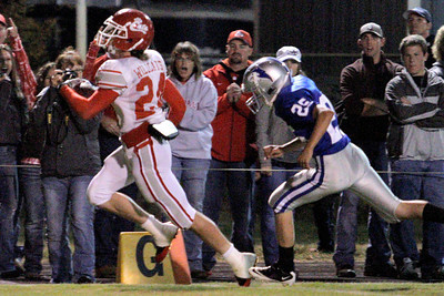 Josh Jackson/The Times-Standard  Cats' #24 scores on the ground during Friday's game in Fortuna.