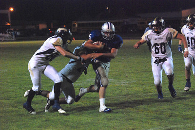 JosŽ Quezada/For the Times-Standard  No. 35 Fortuna on a 30+ yard gain to the Warrior two-yard line.