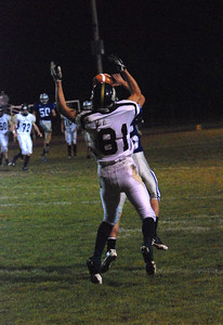 JosŽ Quezada/For the Times-Standard  No. 25 for Fortuna snags an interception from intended receiver No. 81 Del Norte.