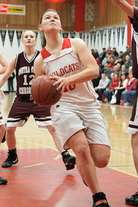 Josh Jackson/The Times-Standard  Wildcats' Kaitlyn Regli drives to the hoop during Saturday's game in Ferndale.