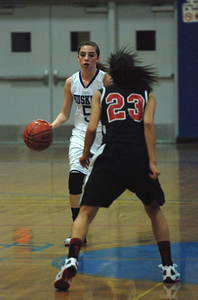 JosŽ Quezada/For the Times-Standard  5 FORT dribbles down court against 23 MACK