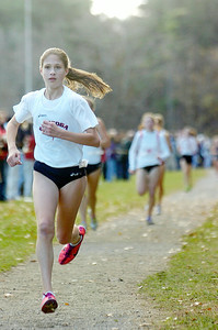 Saratoga girls cross country team Olivia Morrow, eight grader, makes her way to the finish line in seventh place during the Section II cross country championships at the Saratoga Spa State Park on Friday. Photo Erica Miller 11/4/11 spt_GirlsXC6_Sat