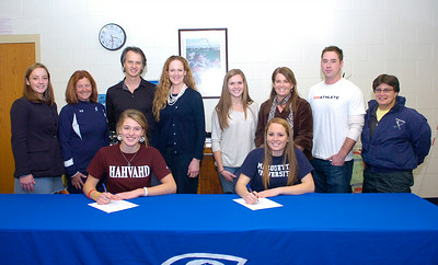 "Family members and coaches surround Saratoga Springs varsity lacrosse players Isabella ""Iszy"" Wager, left, and Emma Kern who have signed letters of intent to play at Harvard and Marquette Universities respectively. Behind from left are: Iszy's cousin Caroline Loyola, SSHS girls varsity lacrosse coach Sue Hoffman, parents John Wager and Alisa Dalton-Wager, Emma's sister Molly and mother Becky Kern, personal trainer Aidan Howley who coached the students on speed and agility, and Emma's field hockey coach JoAnne Hostig. Ed Burke 11/30/11"
