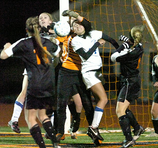 Bethlehem goalie Katie Nickles reaches for the ball around Saratoga's Ellery Bianco during friday's Class AA semi-final at Schuylerville. Ed Burke 11/4/11