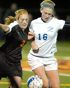 Saratoga's Iszy Wager battles with Bethlehem's Elle Lutz during Friday's Class AA semi-final at Schuylerville. Ed Burke 11/4/11