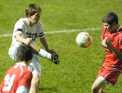 Guilderland's Lucas Pasquerella flinches from a kick by Shen's Michael Jenkins during Thursday's Class AA semi-final in Colonie. Ed Burke 11/3/11