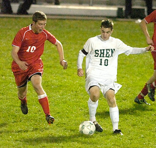 Shen's Marcus Moore is challenged by Guilderland's Vito Mesiti during Thursday's Class AA semi-final at Colonie. Ed Burke 11/3/11