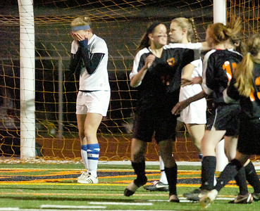 Saratoga's Iszy Wager puts her head in her hands after Bethlehem scored their first goal during Friday's semi-final in Schuylerville. Ed Burke 11/4/11