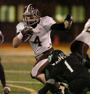 BHBL's Daniel Porter carries the ball during Friday's Class A semi at Dietz Stadium in Kingston. Ed Burke 11/18/11