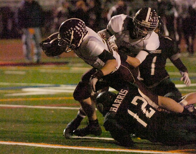 BHBL's Thomas Ruppel dives for a 2nd quarter touchdown during Friday's Class A state semi-final against Cornwall. Cornwall's Jesse Harris (12) on the play. Ed Burke 11/18/11
