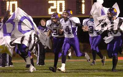 The Scotties run through their banner at the beginning of Friday's Super Bowl. Ed Burke 11/6/09