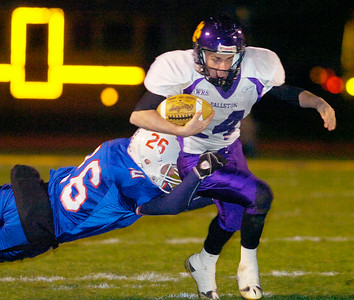 Saratoga's Jacob Burnell hits Ballston Spa's Mark Seager during Friday's Super Bowl. Ed Burke 11/6/09