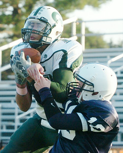 Jordan James, Greenwich, catches the football in the end zone (??) scoring a touchdown against Timmy Foust, Rensselaer, during the Class D Finals Saturday afternoon at Shenendehowa. Photo Erica Miller 11/7/09 spt_RensGreen6_Sun