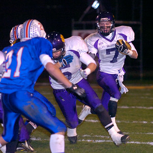 Ballston's Matt Clark clears the way as teammate Kyle Warmt runs the ball during Friday's Super Bowl against Saratoga in Colonie. Ed Burke 11/6/09