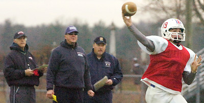 Saratoga Springs Quarterback Luke Fauler pitches the ball down the field for a pass during their practice Thursday afternoon before their State Semifinal game on Saturday. Photo Erica Miller 11/19/09 spt_TogaPract2_Fri