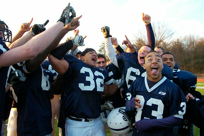 Rensselaer Varsity Football teammates cheer after winning the Class D finals against Greenwich Saturday afternoon at Shenendehowa. Photo Erica Miller 11/7/09 spt_RensGreen2_Sun