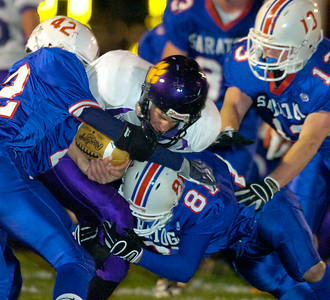 Ballston Spa quarterback Mark Seager runs into triple defense by Saratoga's, from left; Ryan Seymour, Shawn Sweeney and Ford Plowman. Ed Burke 11/6/09