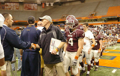Led by Coach Matt Shell, teammates of BHBL shakes the opponents hands after being defeated by Sweet Home during their Class A NYS Tournament at the Syracuse Carrier Dome. Photo Erica Miller 11/28/09 spt_BHBLsweet4_Sun