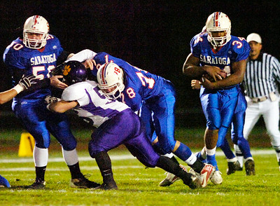 Tony DeLoatch carries the ball during Friday's Super Bowl versus Ballston Spa. Ed Burke 11/6/09