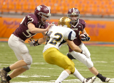 Tyler Paluba, BHBL, carries the football down the field as teammate Jake Batty tackles Steven Spencer, Sweet Home, during their Class A NYS Tournament at the Syracuse Carrier Dome. Photo Erica Miller 11/28/09 spt_BHBLsweet2_Sun