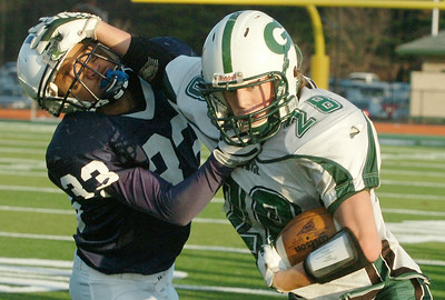 Tyler Pruiksma, Greenwich, runs down the sideline with the football against Defense-man Marquee James, Rensselaer, during their Class D Finals Saturday afternoon at Shenendehowa. Photo Erica Miller 11/7/09 spt_RensGreen4_Sun