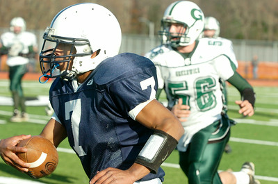 Mico Delos Santos, Rensselaer, runs down the sideline with the football during the Class D finals against Greenwich Saturday afternoon at Shenendehowa. Photo Erica Miller 11/7/09 spt_RensGreen5_Sun