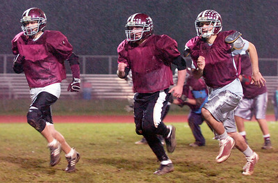 BH-BL Linemen William Fisher, Dylan Wydronkowski, and Kevin Knightes at their practice Thursday evening before their State Semifinals game this evening. Photo Erica Miller 11/19/09 spt_BHBLprac1_Fri