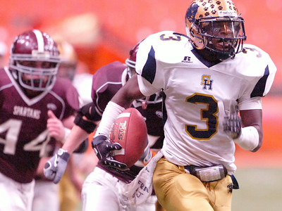 D.J. Nettles, Sweet Home, runs with the football down the sidelines while BHBL chases after during their Class A NYS Tournament at the Syracuse Carrier Dome. Photo Erica Miller 11/28/09 spt_BHBLsweet1_Sun