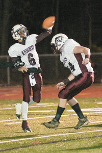 Lansingburgh Knights' Quarterback Carlos Grillo launches the ball downfield during their game against the Burnt-Hills Spartans Saturday evening. Photo Eric Jenks 11/6/10