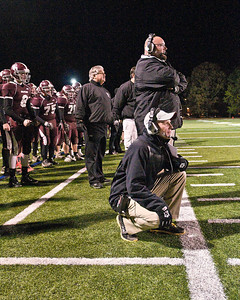 Burnt Hills Head Coach Matt Shell (bottom right) looks on during a game against Lansinburgh Knights. Photo Eric Jenks 11/6/10