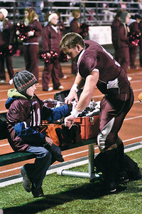 Jacob Shell tapes up Burnt Hills Spartan Michael Brienza during a game, Photo Eric Jenks 11/6/10