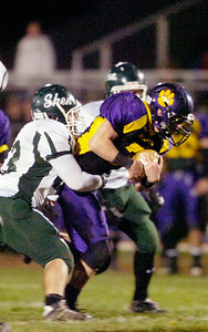 Ballston Spa's Kyle Warmt is tackled by Shenendehowa's Craig Neumann during their semifinals football game Friday evening at Ballston Spa. Photo Erica Miller 10/29/10 spt_BspaShen3_Sat