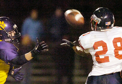 Ballston's Carm Pascuito tries to break up a pass to Schenectady's Mister Taylor during Friday's Sectional matchup in Ballston. The pass was good and Pascuito made the tackle after the reception. Ed Burke 10/22/10