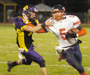 Ballston's Kyle Warmt closes in on Schenectady's Tim Cox during Friday's game in Ballston. Ed Burke 10/22/10