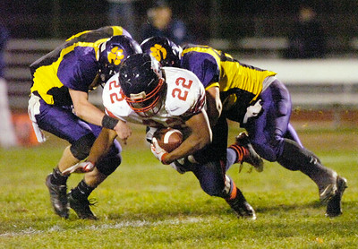 Schnectady's Kirieme Pitts is tandem-tackled by Ballston's Kyle Warmt, left, and Chris Ohnsman during Friday's game at Ballston. Ed Burke 10/22/10
