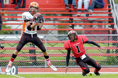 Schuylerville's Shane Lyon catches the pass interception intended for Albany Academy's Jasiri Currie during their playoff football game at Albany Academy Saturday afternoon. Photo Erica Miller 10/23/10 spt_SchyAlb1_Sun