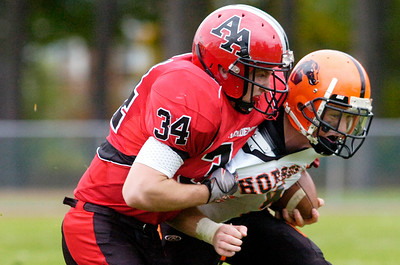 Schuylerville's Mike Vargues carries the ball down the field as he's tackled by Albany Academy's Paolo LaPietra during their playoff football game at Albany Academy Saturday afternoon. Photo Erica Miller 10/23/10 spt_SchyAlb2_Sun