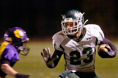 Shenendehowa's Bronson Greene carries the ball down the field during their semifinals football game against Ballston Spa Friday evening at Ballston Spa. Photo Erica Miller 10/29/10 cn_ShenBspa2