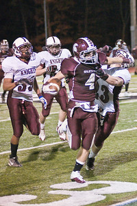 Burnt Hills-Ballston Lake Spartan Evan Nusbaum pushes past Lansingburgh Knight Anthony Fogarty Saturday night during the 2010 Section II Class A Super Bowl. Photo Eric Jenks 11/6/10