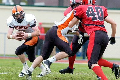Schuylerville's Mike Vargues carries the ball down the field during their playoff football game against Albany Academy at Albany Academy Saturday afternoon. Photo Erica Miller 10/23/10 spt_SchyAlb4_Sun