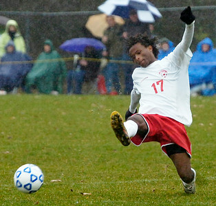 Waterford Halfmoon player Fre Breen kicks the ball in the air during their soccer game against Northern Adirondack Saturday afternoon in Queensbury. Photo Erica Miller 11/14/09 spt_WaterNAdk3_Sun