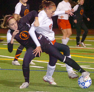 Madison Trombley, Plattsburgh (left), and Amber Maiello, Mechanicville, battle for the soccer ball during their state semifinal in Stillwater Friday evening. Photo Erica Miller 11/13/09 spt_MechPlatts1_Sat
