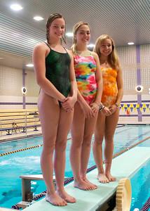 Ballston Spa divers from left: Addie Walkowiak, Nicole Kverek and Devon Delay. Ed Burke 11/18/09