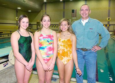 Ballston Spa divers from left: Addie Walkowiak, Nicole Kverek and Devon Delay with coach Dennis Hogan Ed Burke 11/18/09