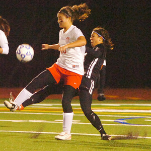 Andrea Mastropietro, Mechanicville, and Charisse Abellard, Plattsburgh, battle for the soccer ball during their state semifinal in Stillwater Friday evening. Photo Erica Miller 11/13/09 spt_MechPlatts2_Sat