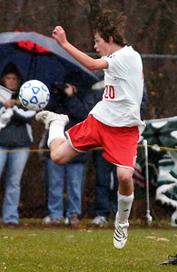 Waterford Halfmoon player Garrett Archambeault kicks the ball in the air during their soccer game against Northern Adirondack Saturday afternoon in Queensbury. Photo Erica Miller 11/14/09 spt_WaterNAdk2_Sun